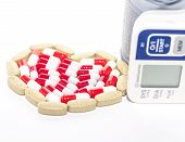 picture of placebo  - blood pressure device and tablets in heart - JPG