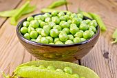 stock photo of pea  - Green peas in a brown bowl - JPG