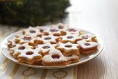 foto of linzer  - Closeup of Christmas Linzer cookies on the table