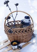 foto of blanket snow  - Basket With Thermos Of Mulled Wine And Knitted Blanket On Sledge In A Snow - JPG