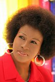 picture of middle-age  - Middle Aged Black woman portrait outdoors red jacket - JPG