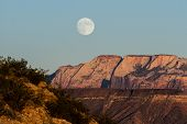 picture of superstition mountains  - beautiful full moon rising over the mountains of southwestern Utah