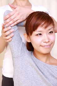 stock photo of chiropractic  - woman getting chiropractic in the chiropractic office - JPG