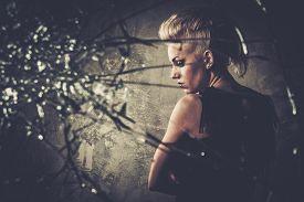image of anarchists  - Punk girl behind broken glass  - JPG