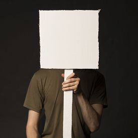 stock photo of anarchists  - Faceless person holding a blank square sign  - JPG