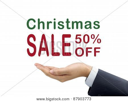 Christmas Sale 50 Percent Off Holding By Businessman's Hand