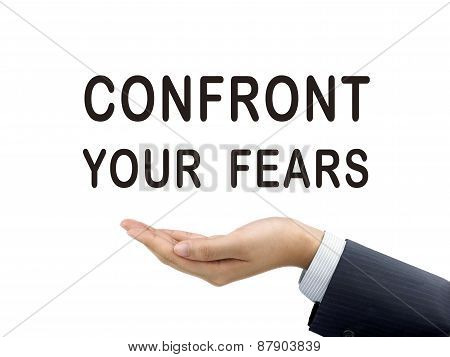 Confront Your Fears Words Holding By Businessman's Hand