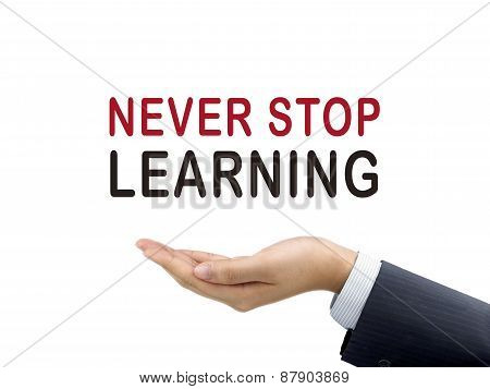 Never Stop Learning Words Holding By Businessman's Hand