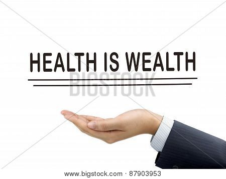 Health Is Wealth Words Holding By Businessman's Hand