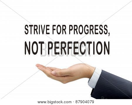 Strive For Progress Not Perfection Holding By Businessman's Hand