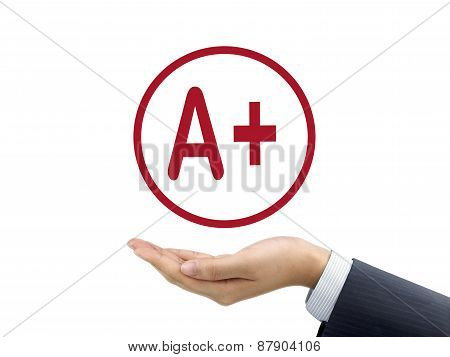 A Plus Grade Holding By Businessman's Hand