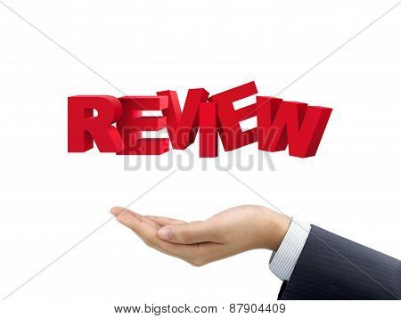 Businessman's Hand Holding Review Words