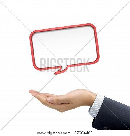 Businessman's Hand Holding Speech Bubble