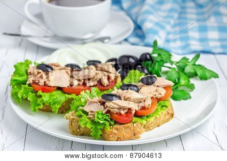 Tuna Fish Sandwiches On The White Plate And Coffee