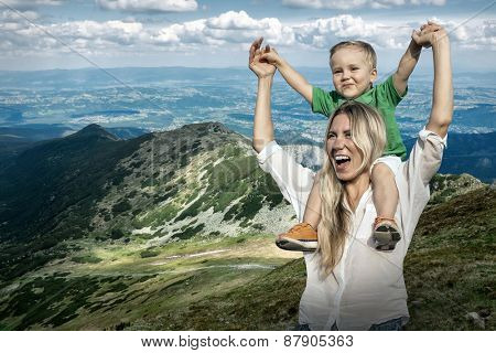 Happiness Mother and son on the Beautiful view of the mountains