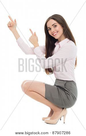 Woman crouching and pointing fingers