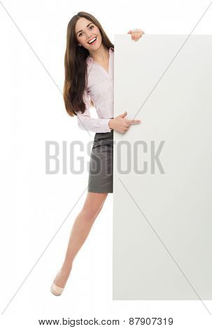 Woman standing next to big white poster