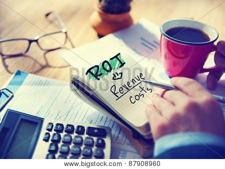 Businessman Notepad Word ROI Concept