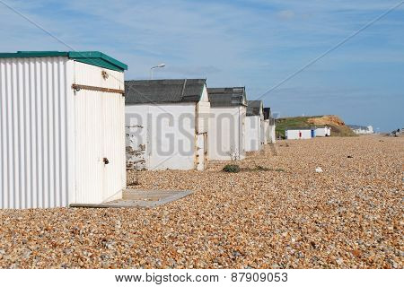 HASTINGS, ENGLAND - MARCH 10, 2015: A row of traditional British beach huts at Glyne Gap in East Sussex. Such beach huts are a common sight at many seaside towns in the UK.