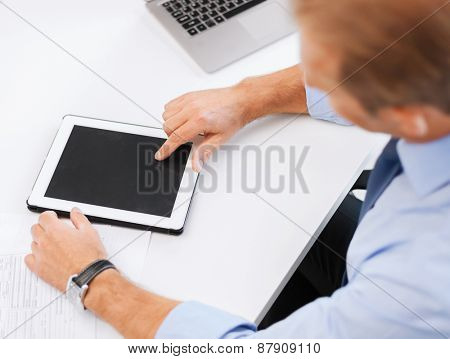 business, office, school and education concept - businessman with tablet pc in office