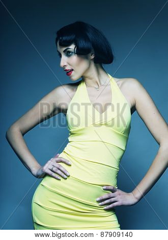 Beautyful woman in vintage style. Black hair and yellow dress.