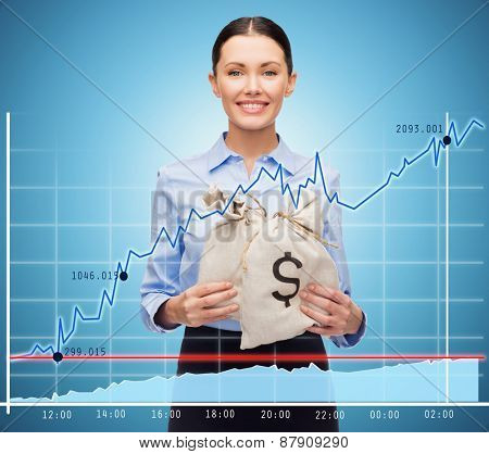 business, people, finances, investments and banking concept - young businesswoman holding money bags with euro and chart over blue background