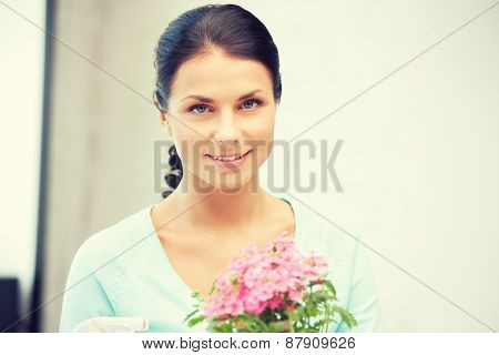 bright picture of lovely housewife with flower.