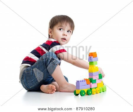 little child with construction set over white backgroun