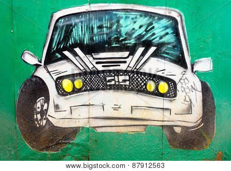 Moscow, April 14: Graffiti On The Wall, Painted White Car On The Green Wall April 14, 2015 In Moscow