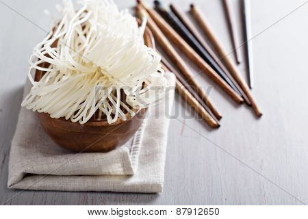 Dry raw rice noodle in a bowl