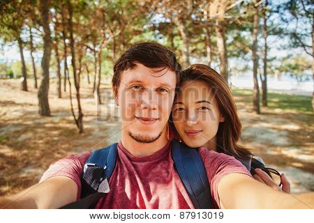 Loving Couple Taking Self-portrait In Summer Forest