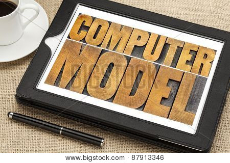 computer model typography - science or research concept -  word abstract in letterpress wood type on a digital tablet