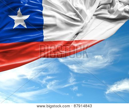 Chilean waving flag on a beautiful day