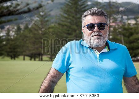 Attractive Bearded Man On A Golf Course