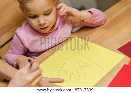 Mother And Child Are Drawing Theirs Hands