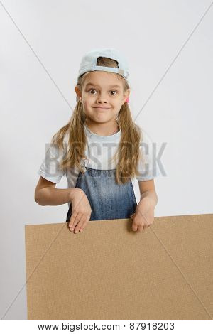 Girl Holding A Wooden Board