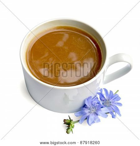 Chicory drink in white cup with blue flower