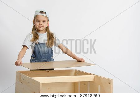Girl Collects The Back Cover Of Chest