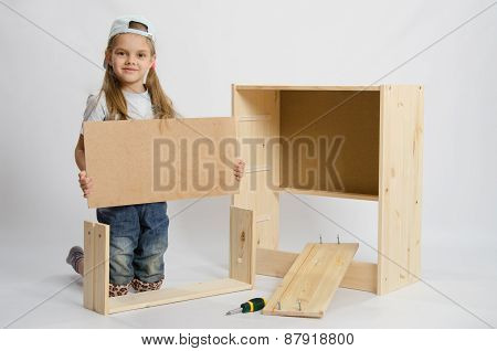 Girl Sets The Bottom Drawer