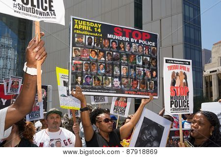 Woman Showing Pictures Of People Murdered By Police