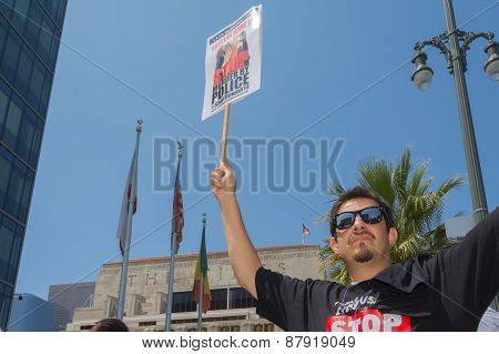 Man Wearing Stop Murder By Police Shirt And Holding Sign