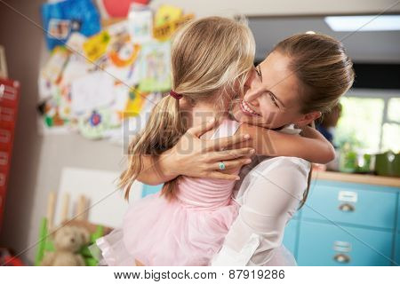 Daughter Hugging Mother Returning From Work