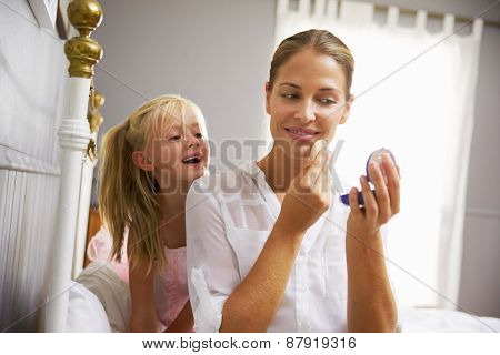 Daughter Watching Working Mother Put On Make Up
