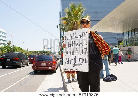 Woman Showing Sign To Passersby