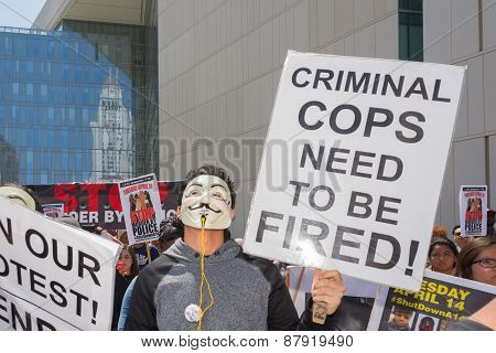 Man Wearing Mask Holding A Sign