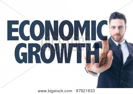 Business man pointing the text: Economic Growth