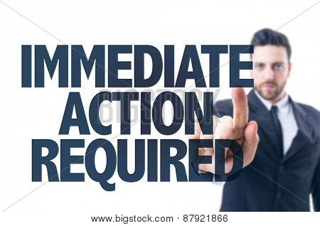 Business man pointing the text: Immediate Action Required