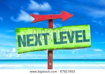 Next Level sign with beach background