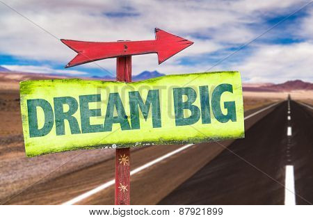 Dream Big sign with road background