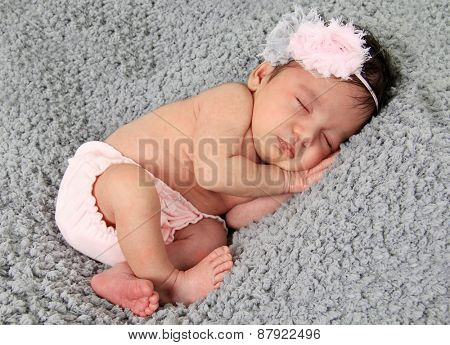 Newborn baby girl of Asian and Caucasian heritage.